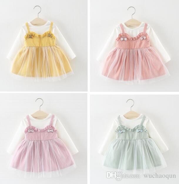 Cinturón faldas del bebé guardapolvos con Jacobs botones amarillos Lotus color Primavera Verano Otoño princesa vestidos de las muchachas del niño niños ropa BY0277