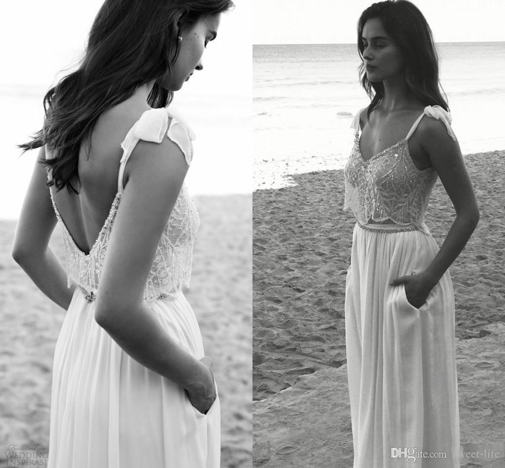 Playa 2020 de encaje de Boho Una línea vestidos de boda del espagueti sin espalda con bolsillos novia de Boho de la gasa atractiva Vestidos de boda
