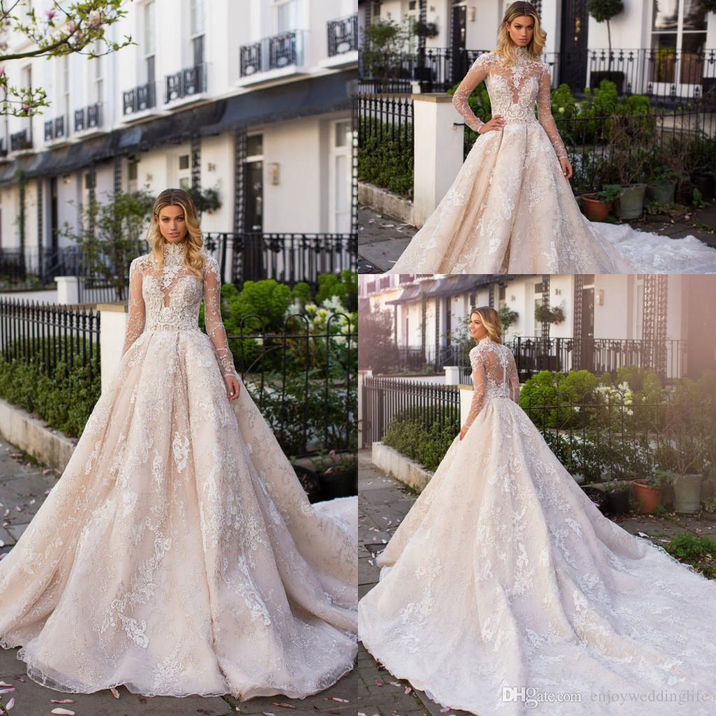2019 Роскошное легкое шампанское в стиле кантри A Line Свадебные платья с высоким воротом и прозрачными длинными рукавами Иллюзорные лифы Кружева Аппликация Свадебные платья