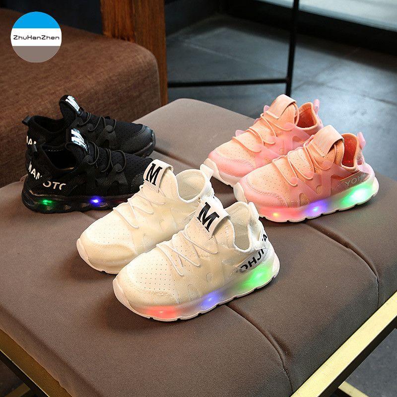 2018 من 1 إلى 3 سنوات أضواء LED الطفل الأحذية الرياضية الفتيان والفتيات عارضة الأحذية متوهجة الوليد الأولى المشي أحذية رياضية عدم الانزلاق لينة