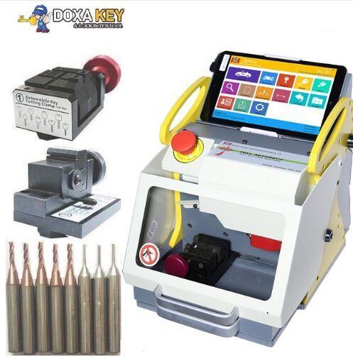 Good quality2 Clamp + Original Sec E9 Laser Key Cutter ,Locksmith key cutter, Auto Locksmith Tool ,SEC-E9 automatic key cutting machine