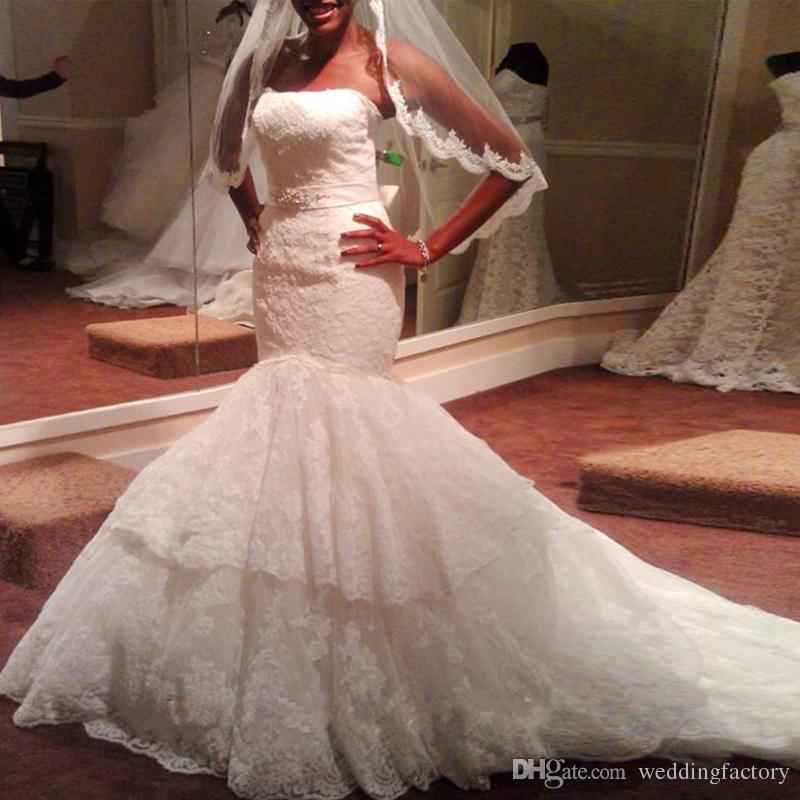 Apliques de encaje vintage Vestido de novia de sirena Sin tirantes Sin mangas Trompeta Vestidos de novia de alta calidad con faja ajustada y llamarada