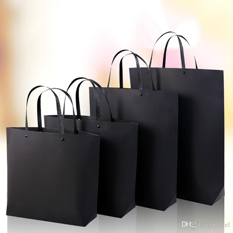 33*25cm+8cm Black card Kraft paper portable Thicken Ship type Rivets Trapezoidal the mall Fashion clothing Custom gift Advertising Bags