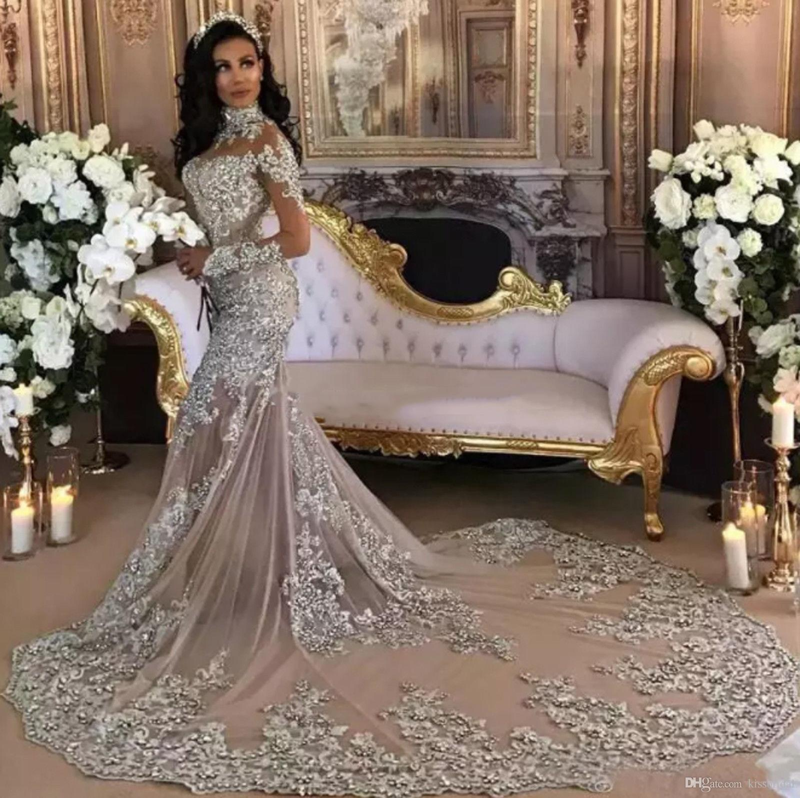 Dubai Arabic Luxury Sparkly 2019 Wedding Dresses Sexy Bling Beaded Lace Applique High Neck Illusion Long Sleeves Mermaid Vintage Bridal Gown