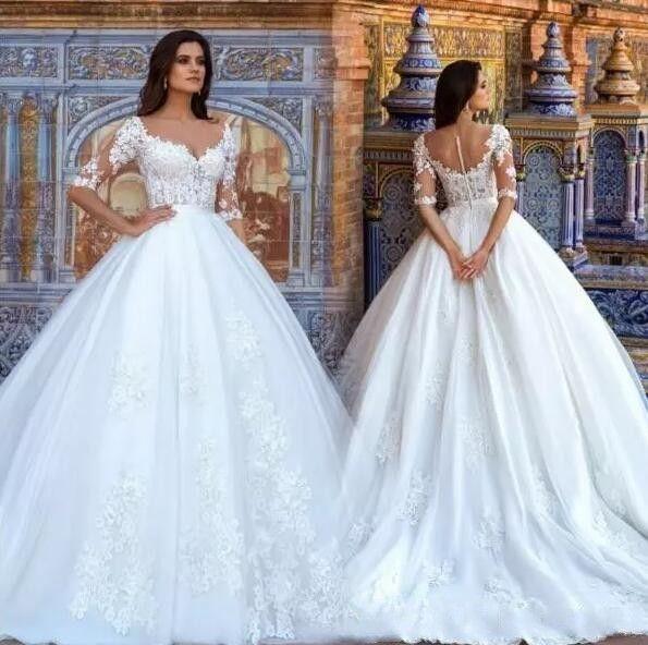 Marfil hinchados de bola vestidos de novia vestido de novia 2018 de boda apliques de tul medias mangas de encaje árabe Dubai Vestidos país playa bodas