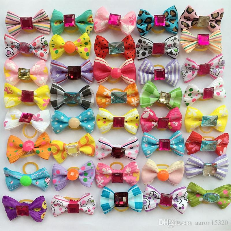 50pcs/lot Dog Hair Bows with Rubber Bands Rhinestone Pearls Bowknot Dog Topknot Bows Cute Dog Cute Pet Grooming Products