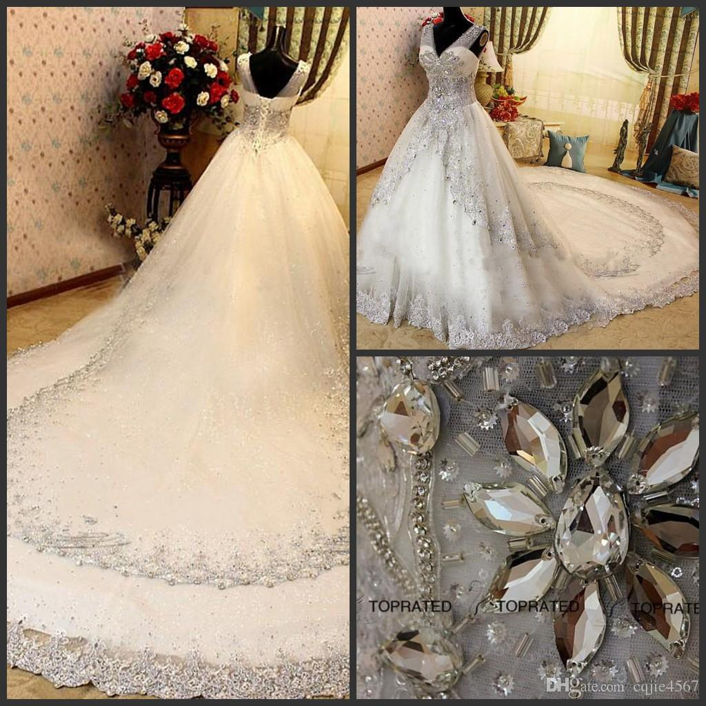 2019 New Sexy Luxury Crystal Wedding Dresses Lace V Neck Sheer Strap SWAROVSKI Bridal Gowns Cathedral Train Free Petticoat vestidos de novia