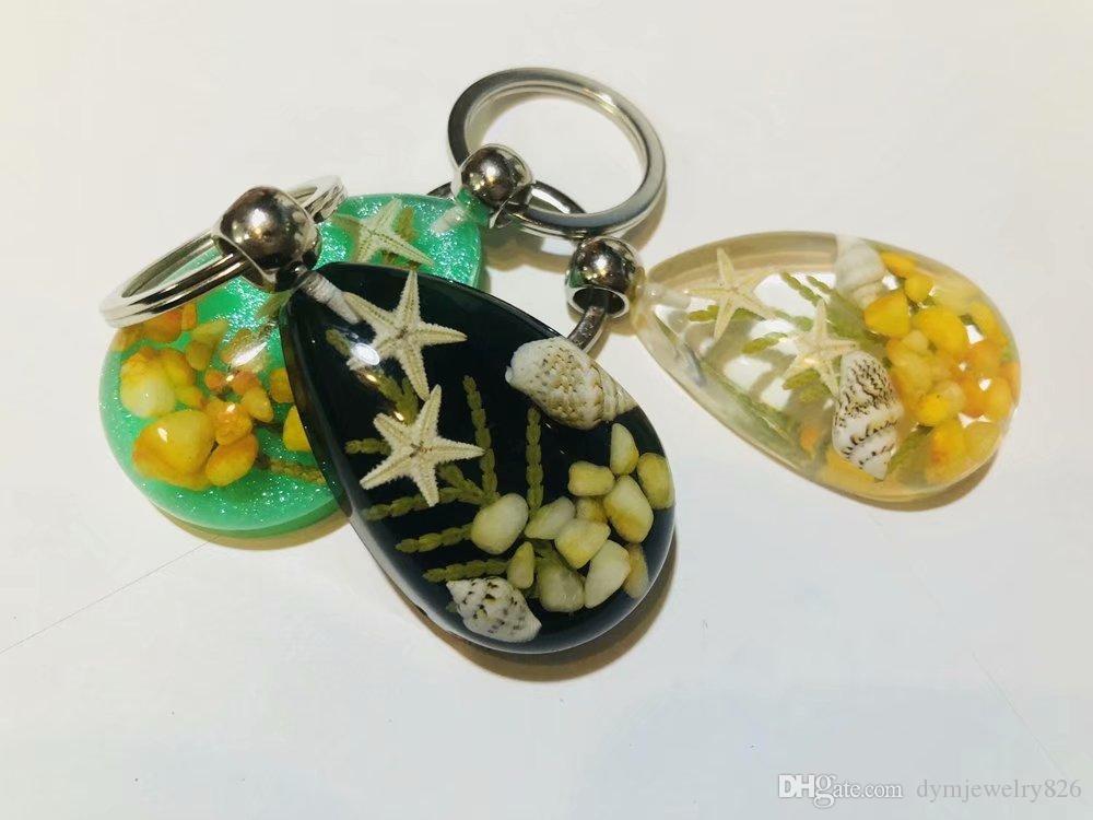 Ücretsiz Kargo yqtdmy 21 adet moda karışık renk damla çift denizyıldızı tasarım taş serin anahtarlık