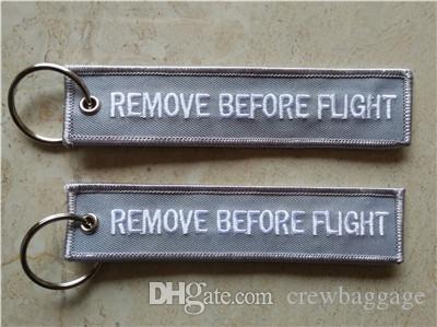 Eliminar antes del vuelo Fácil uso de la cadena de llaves Etiqueta de equipaje con cremallera Polón tejido Llavero de bordado 13x2.8cm 100pcs Lot