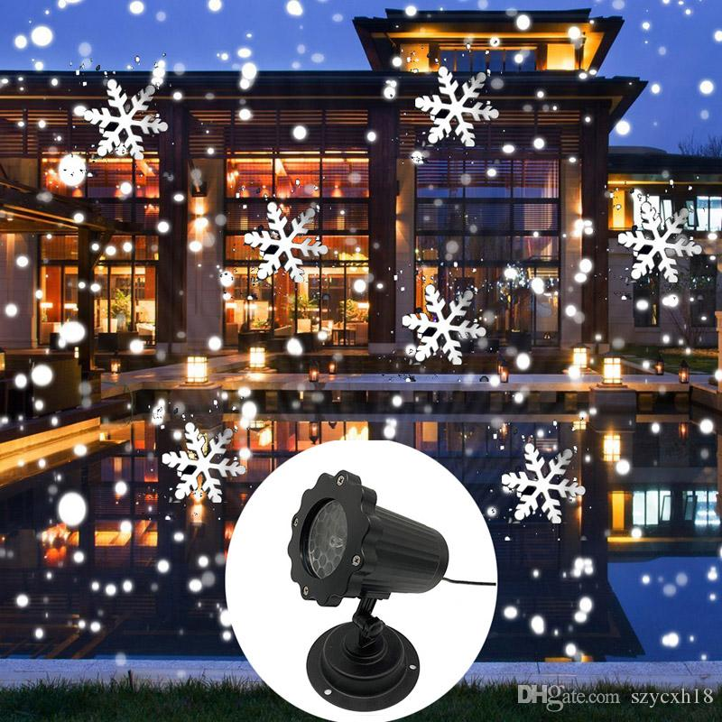 Proiettore di nevicate con luce laser a fiocchi di neve di Natale IP65 Proiettore di luci laser per esterni con neve in movimento per la decorazione di Capodanno