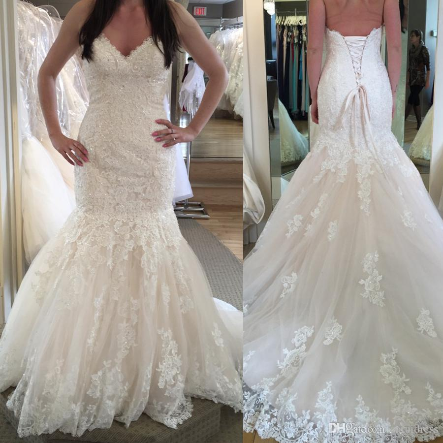 Beautifully Embellished Lace Adorns This Dramatic Fit And Flare Wedding Gown Sweetheart Neckline Corset Back Closure Mermaid Bridal Dress