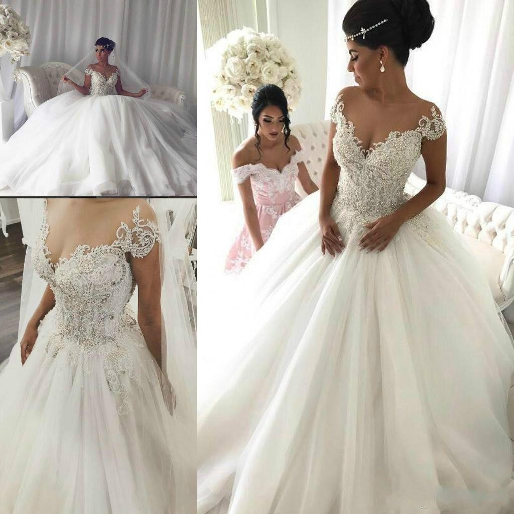 Eleganckie Perły Koraliki Suknie Ślubne Koronki V-Neck Saudyjska Arabia Aplikacje Plus Size Ball Tulle Niestandardowe Vestido De Novia Suknia Bridal Arabska