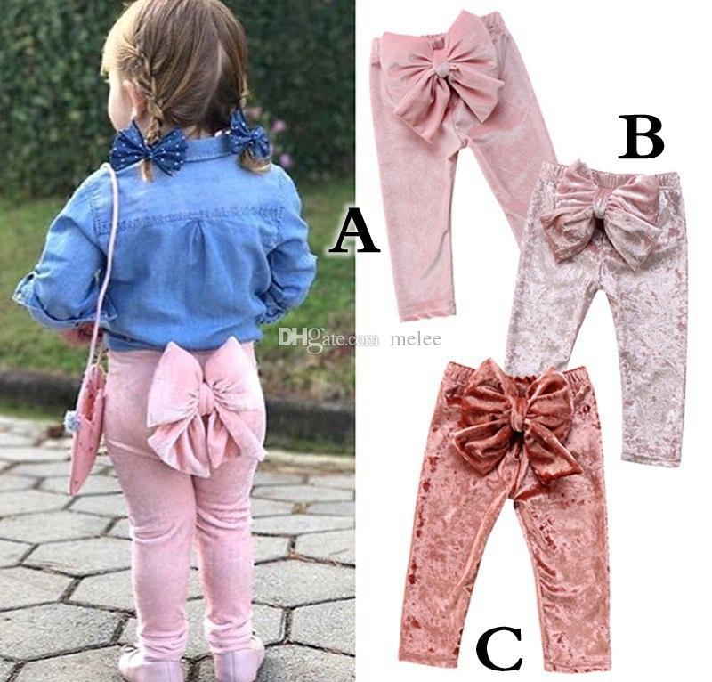 Ins-Fallfrühlingsmädchen-Rüschenhosen nette Kinderbaby-Bowknot-Unterseiten Pleuche lange Hosen-Gamaschen-Hosen-Kleidung