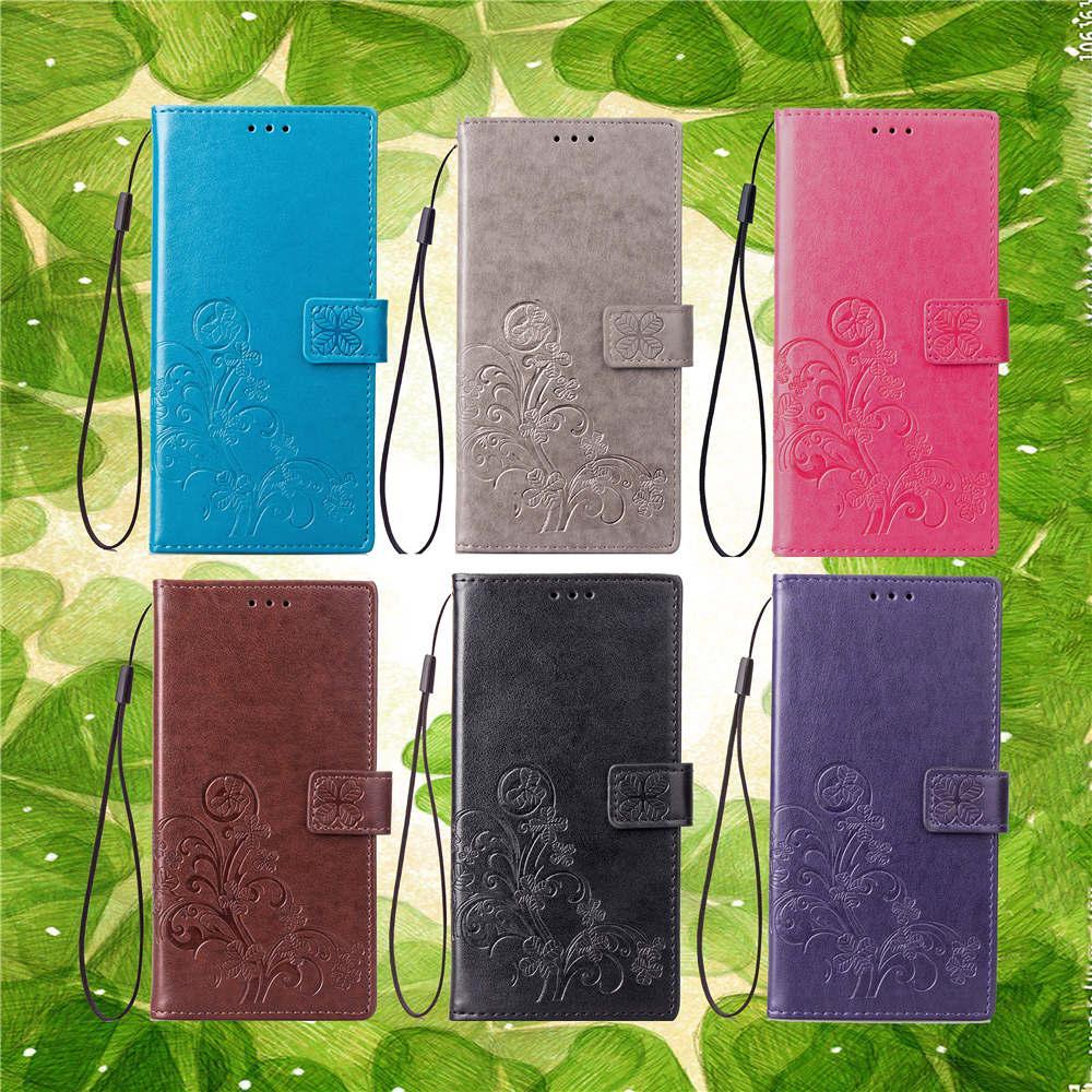 TPU téléphone portable cas plié couverture en cuir PU avec carte portefeuille perforé concave chanceux quatre feuilles modèle fente main sangle