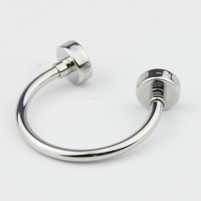 Fashion Inox Ligne Design Keychain Vente chaude Charge-essai, Hommes Europe Célèbre Keychain Noir Résine U