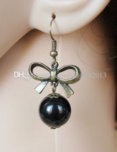 Livraison gratuite étoiles coréennes avec le même style de boucles d'oreilles fashion bow perle noire de la mode féminine classique raffiné élégant