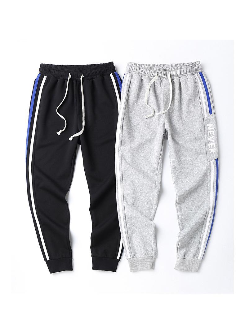 Men Casual Atleta jogging High Street Hip Hop pantaloni elastici Maschio lettere stampate in esecuzione pantaloni lunghi dei pantaloni della matita