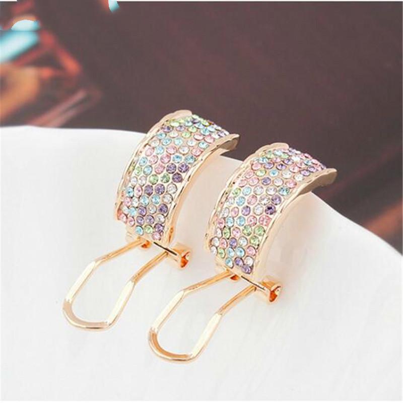 Orecchini di cristallo austriaco trafitto per le donne Gioielli di moda Bella elegante regalo del partito Champagne placcato in oro 8451