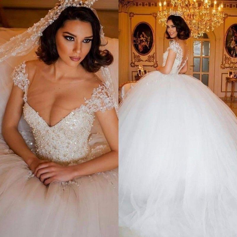 2019 Designer Luxury Arabic Ball Gown Wedding Dresses Illusion V Neck Bodice Pearls Beaded Middle East Dubai Bridal Gowns Princess Big Puffy