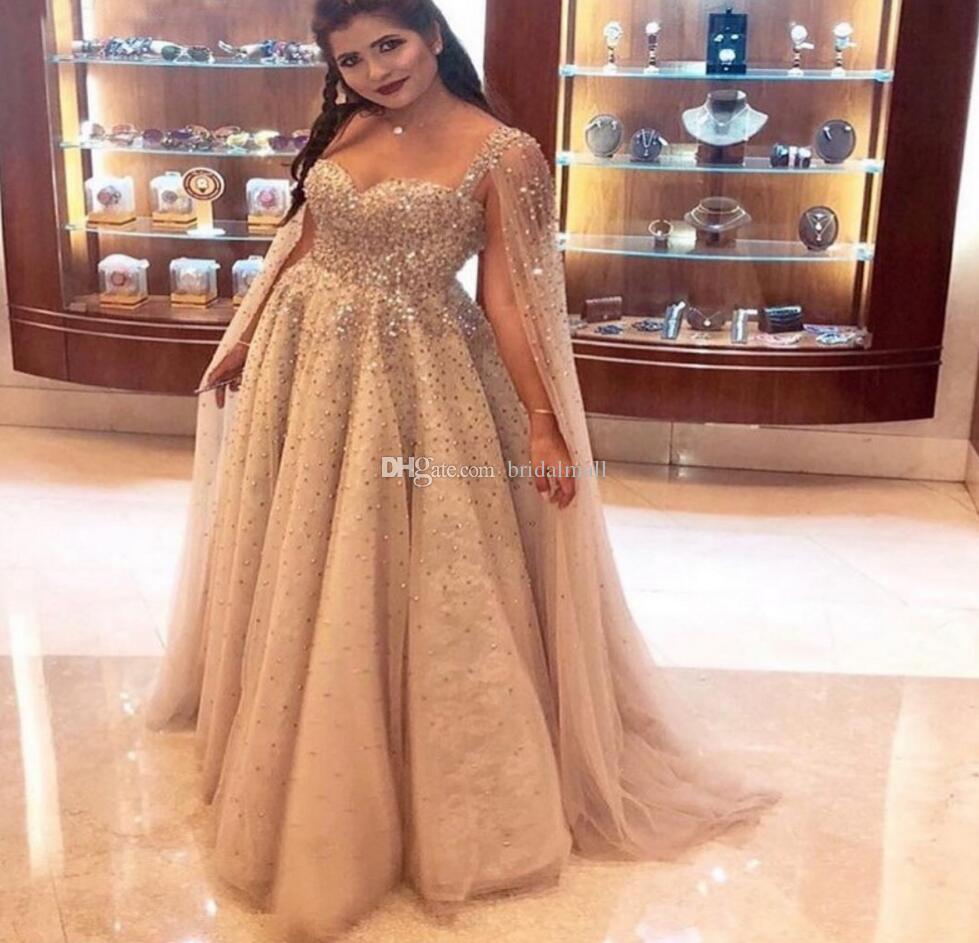 Champagne pärlstav kristall dubai kväll klänningar 2019 saudiarabiska rhinestones tulle prom klänning med cape plus storlek spets formella festklänningar