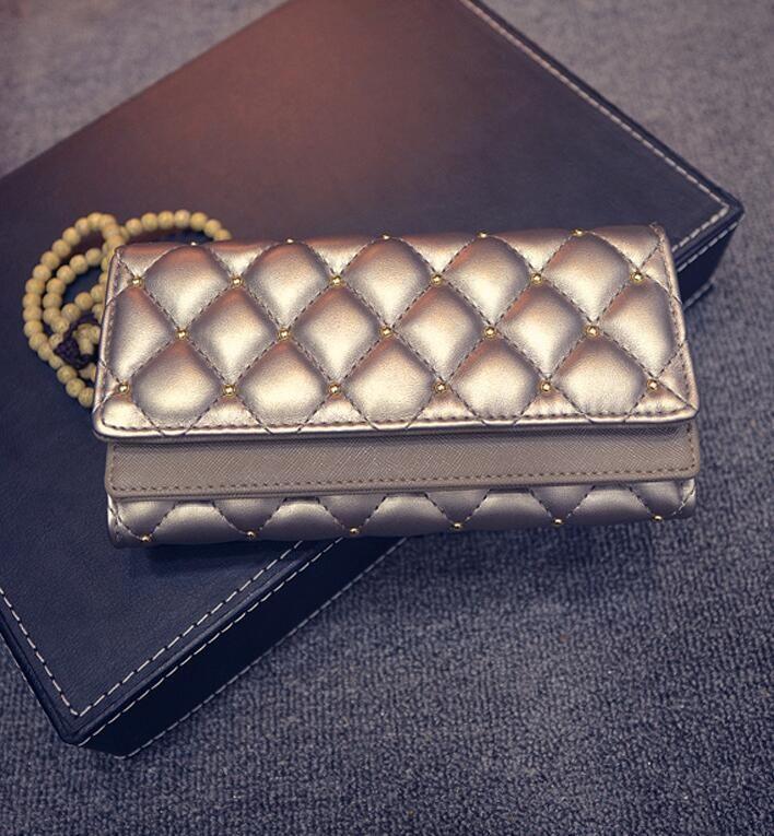 Marca al por mayor de fábrica bolso de cuero cubierta de la carpeta de doble personalidad mano moda mujeres clásico Argyle remache Monedero de la cartera bordado