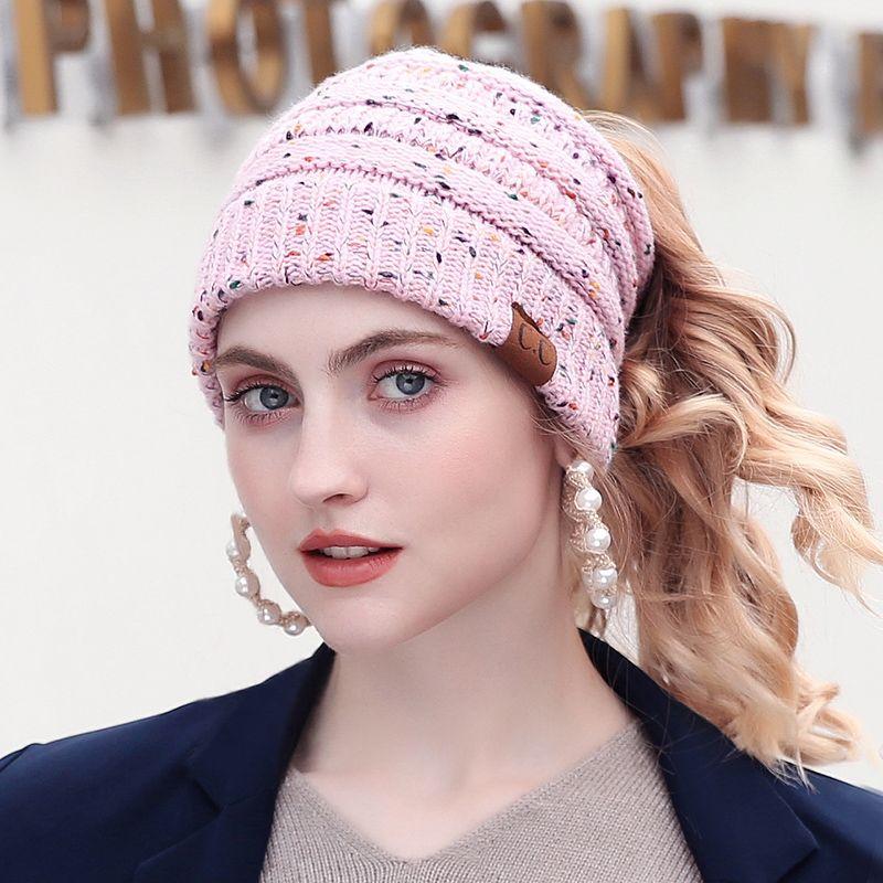 67202e9b675 Drop Shipping 2018 New Fashion CC Warm Winter Hat For Women Ponytail Beanie  Women Stretch Cable Knit Messy Bun Hats ...