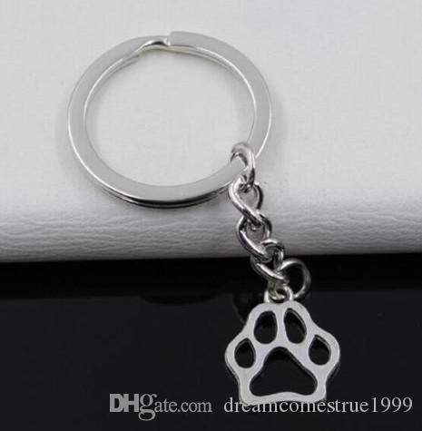20PCS / LOT مفتاح حلقة سلسلة المفاتيح مجوهرات الفضة مطلي باو السحر طباعة 19 17mm و*