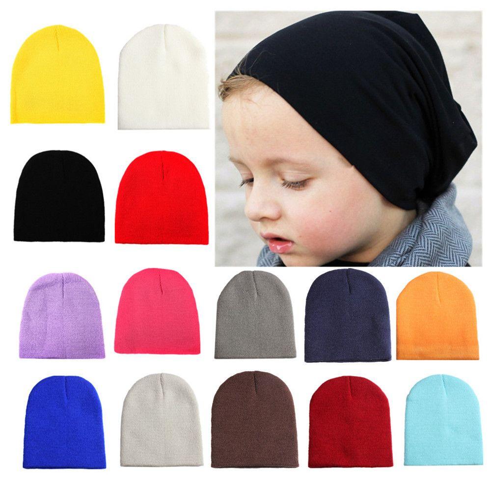 Hot New Baby woolen knitted hat joker solid color joker Autumn and winter Warm baby ear cap