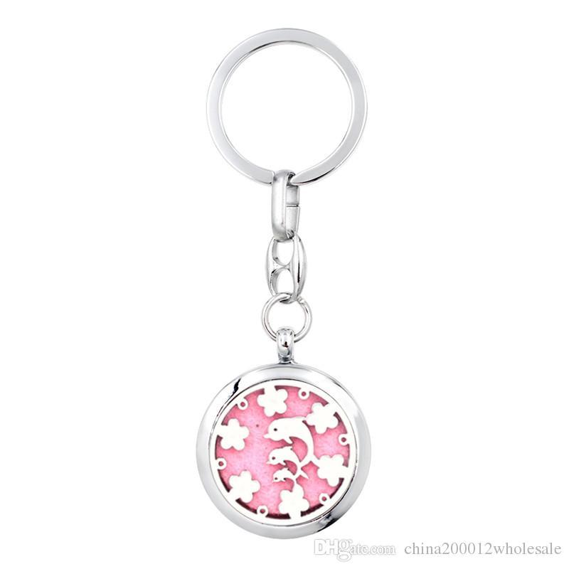 Adorável golfinho chaveiro de beisebol Perfume Difusor Essencial Aromaterapia Locket Chaveiro Liga 30mm Medalhão Oco Chaveiro com 5pads