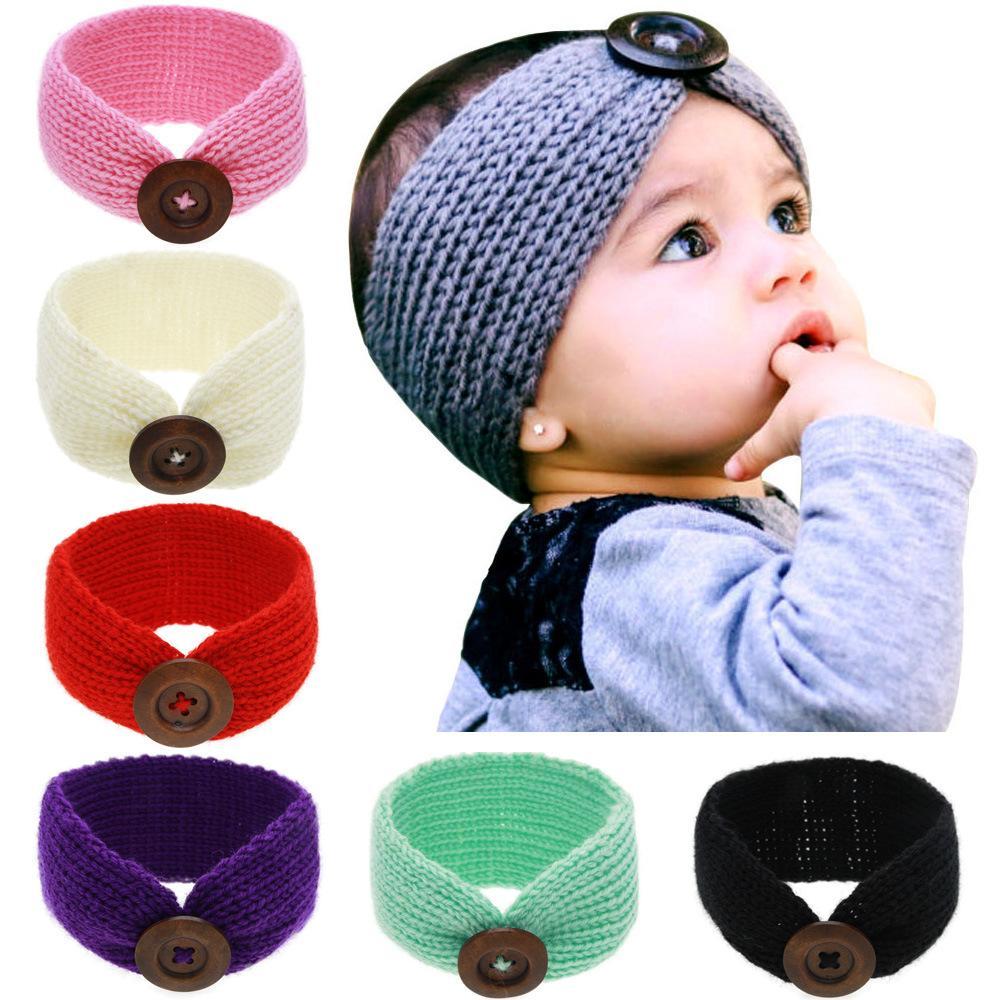 طفل الفتيات الصوف الكروشيه عقال متماسكة hairband مع زر ديكور الشتاء الوليد الرضيع الأذن دفئا رئيس حك 14 ألوان kha0