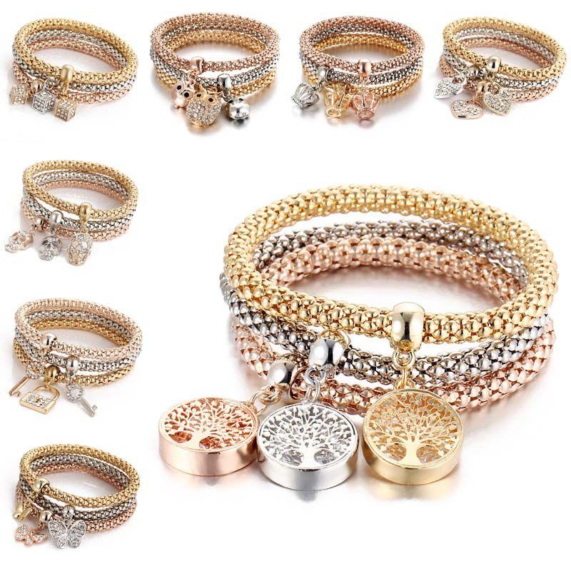 3pcs / set elástico pulsera de cristal del árbol de diamante de la corona del corazón de la vida de la mariposa del cráneo del encanto de la pulsera brazalete fija la joyería nave de la gota 320179