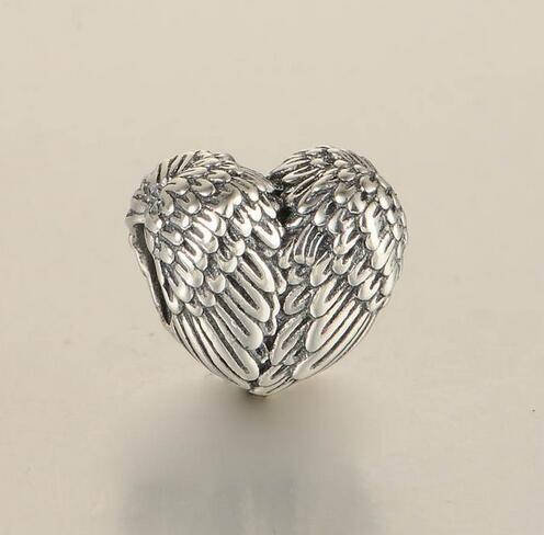 charm pandora coeur plume