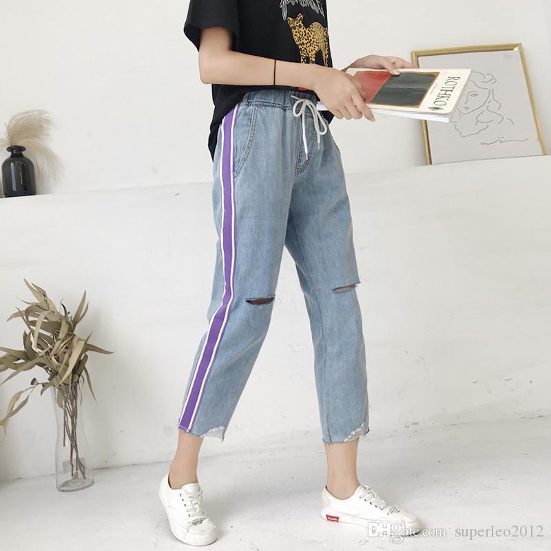 Jeans largos rectos de las mujeres rasgados pantalones de mezclilla Barras laterales agujeros Jeans casuales BF Street Style los pantalones de mezclilla elásticos Wasit lápiz LMORHF