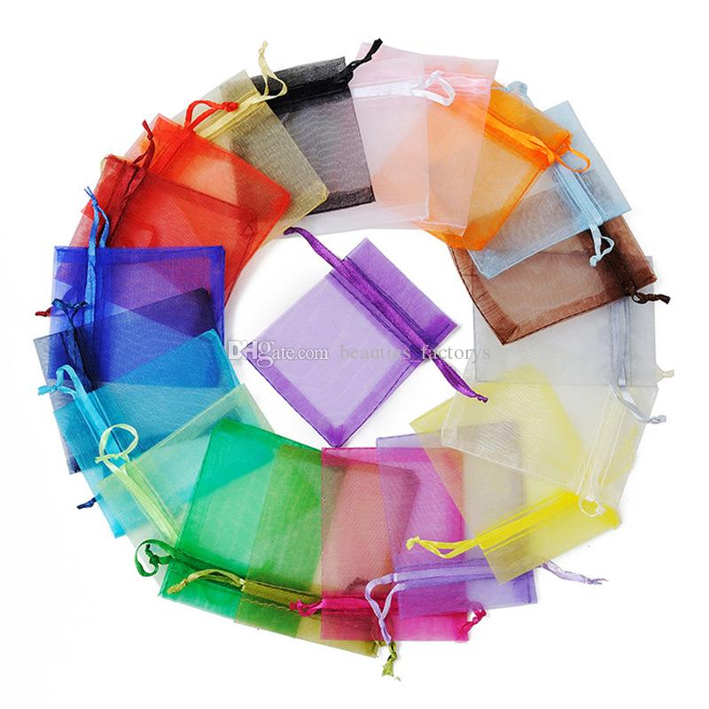 100pcs التي الأورجانزا الرباط الحقائب والمجوهرات الحقائب حفل زفاف لصالح التعبئة حقيبة عيد الميلاد هدية حقيبة 7x9 cm (2.75x3.5 بوصة) متعدد الألوان