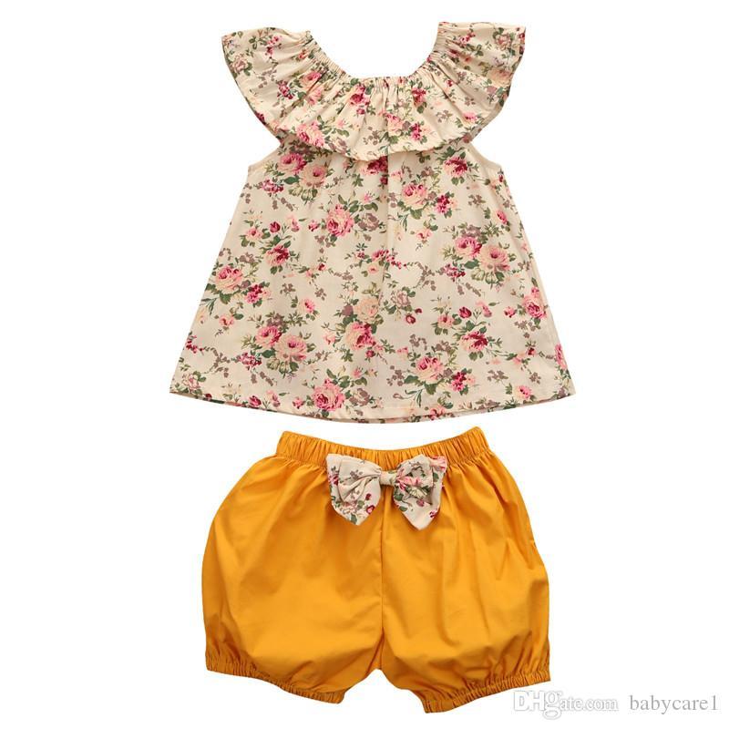 Sommer Neugeborene Baby-Kleidung Blumenhemd + Beugen-Knoten Shorts 2ST Outfits Kleinkind Kinderkleidung Set