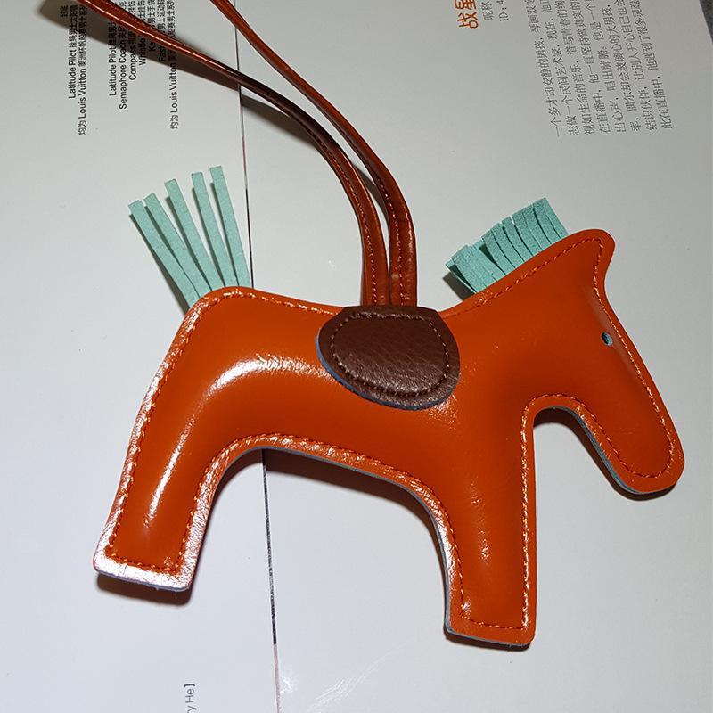FancyFantasy de lujo famosos cuero hechos a mano llavero del caballo dominante animal Cadena Mujeres del encanto del bolso pendiente de los accesorios K-282