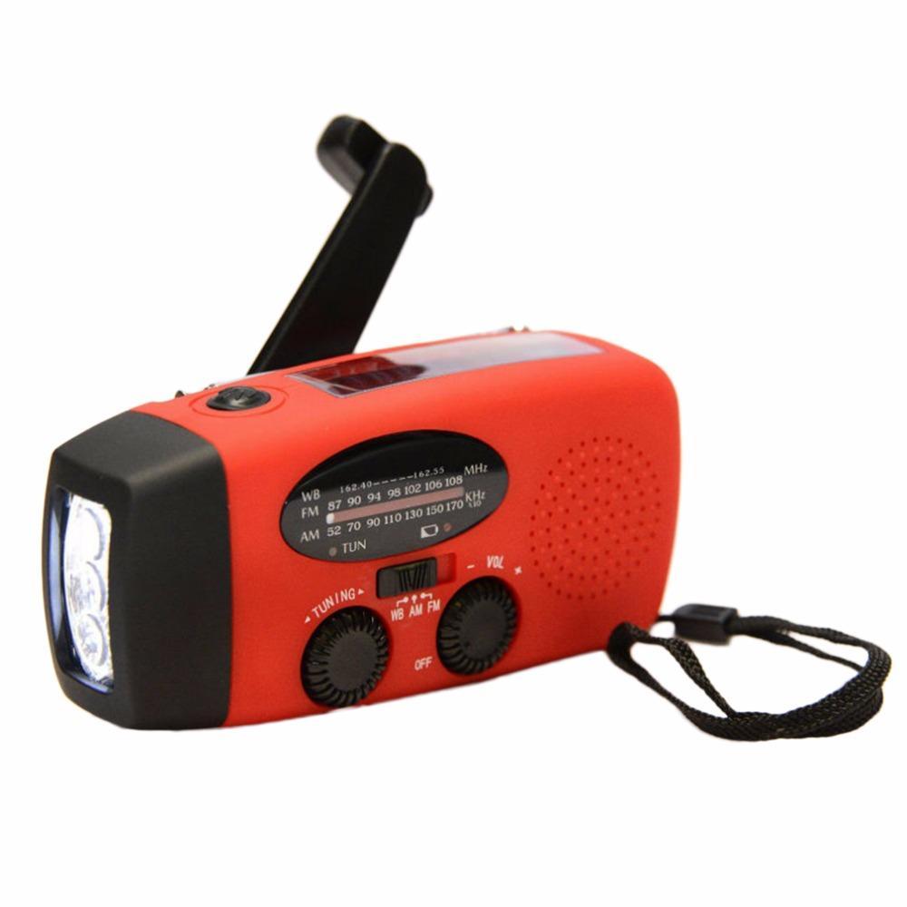 Freeshiping nuovo protable Solar Radio manovella caricatore del telefono autoalimentato 3 LED torcia AM / FM / WB Radio torcia caricabatterie strumenti di sopravvivenza
