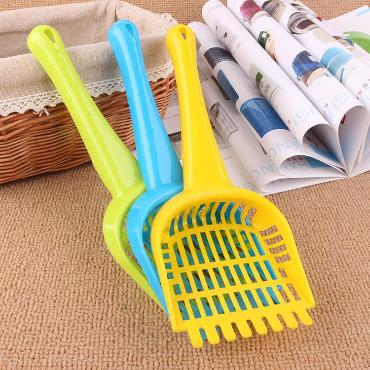 Wholesale new blue yellow orange pink four color pet cat litter shovel random hair pet cat toilet cleaning supplies.DC-481