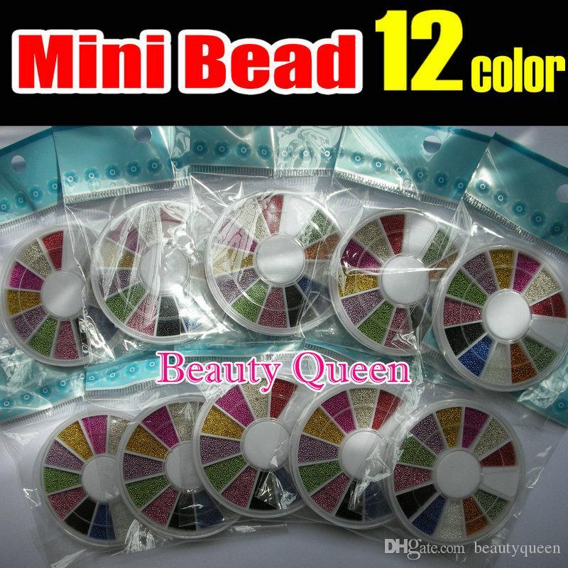 (20wheels / lot) 12 Mischfarben Micro Mini Ball 0,9 mm Korn Bean Caviar Nagel Kunst 3D Spitze-Spitze-Dekoration mit Rad Maniküre DIY NEU