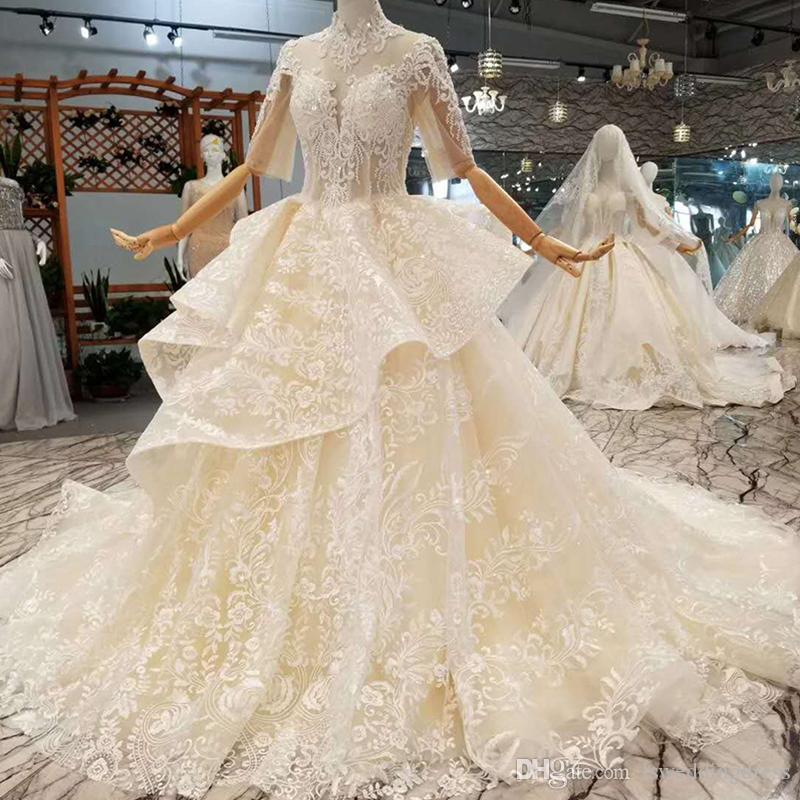 Luxury Champagne Wedding Gowns Illusion High Neck Half Sleeves Applique Open Keyhole Back Puffy Flowers Wedding Dress With Peplum Long Train