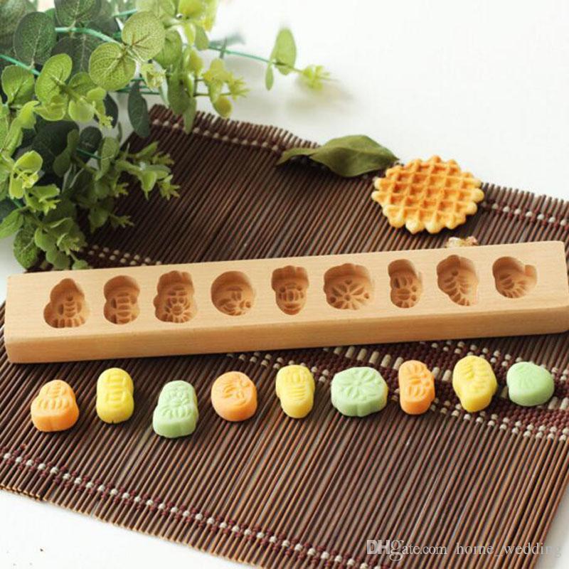Venta al por mayor 20 unids moldes de pastel de madera Mooncake moldes personajes chinos patrón de flores Mooncake herramienta de decoración envío gratis