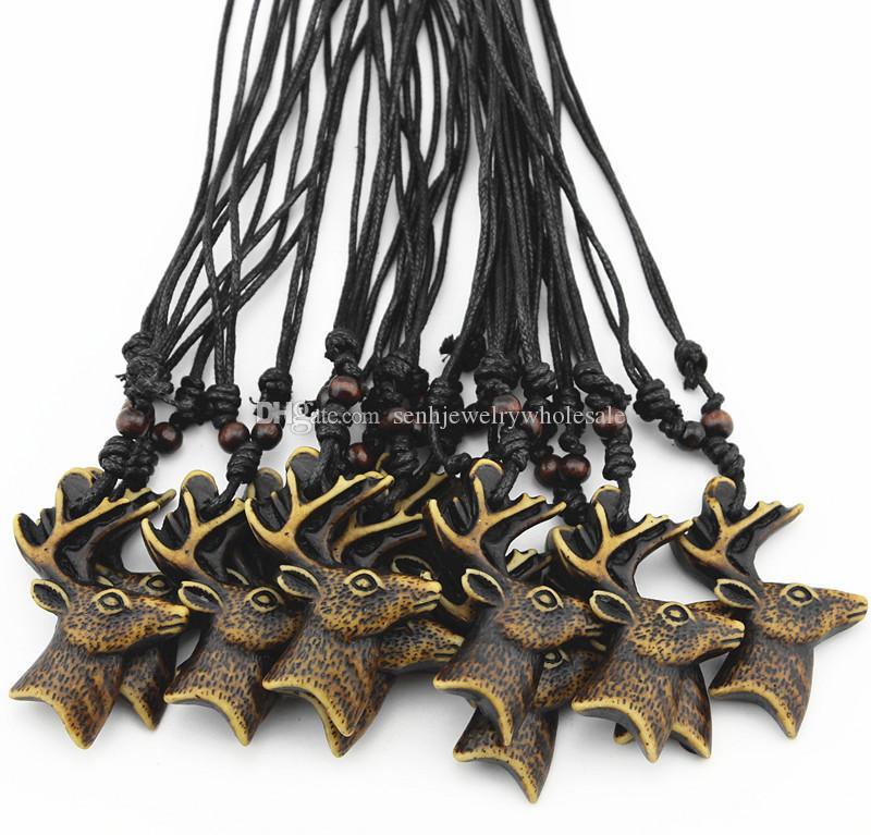 Joyería Al Por Mayor 12 UNIDS / LOTE 12 unids Yak Bone Navidad Tallada Deer Deer Reno Cabeza Collar Gargantilla Lucky presenta regalo de navidad MN526