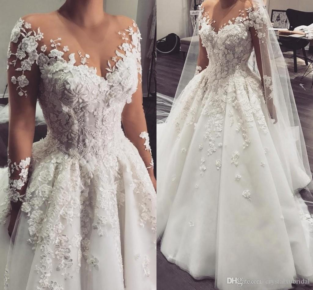 2018 Arabic A Line Wedding Dresses Sheer Jewel Neck Long Sleeves Lace Appliques 3D Flowers Beaded Plus Size Court Train Tulle Bridal Gowns