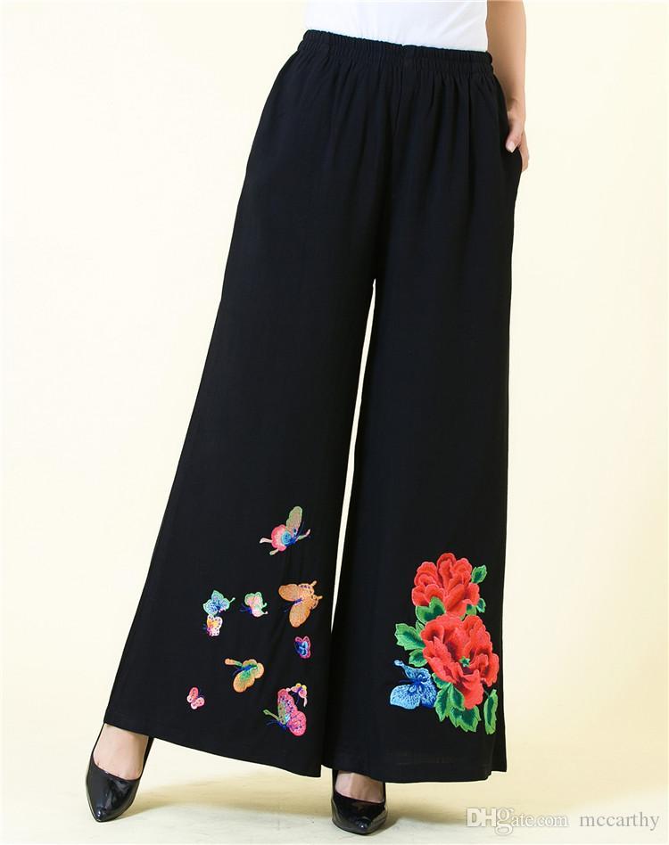 Los pantalones del bordado de las mujeres elásticos de la cintura más el tamaño de los pantalones anchos de pierna de algodón de tendencia nacional de estilo chino casual capris jzn0802