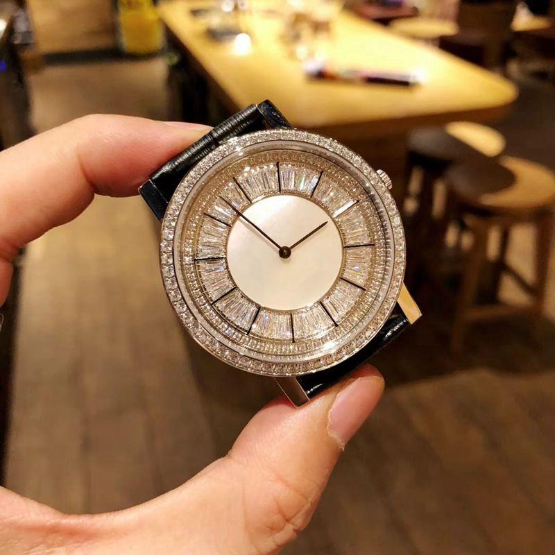 moda elegante dos homens e das mulheres relógios. Design de mostradores com diamantes e pedras preciosas. Movimento de quartzo importado. Diamante de aço 316 c