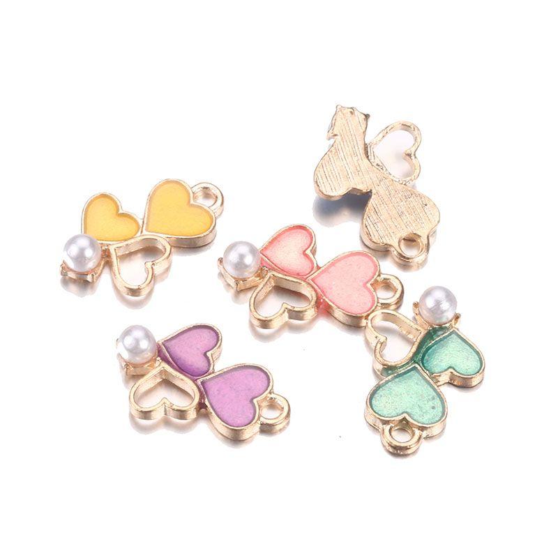 Commercio all'ingrosso colorato doppio cuore fascino smalto moda perla elegante trovare per il pendente della collana braccialetto gioielli fai da te fare