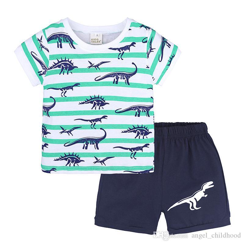 Ropa infantil de verano Conjuntos de ropa para niños Camiseta de algodón a rayas + Pantalones 2pcs Conjunto de ropa para bebés bebés Dinosaurio