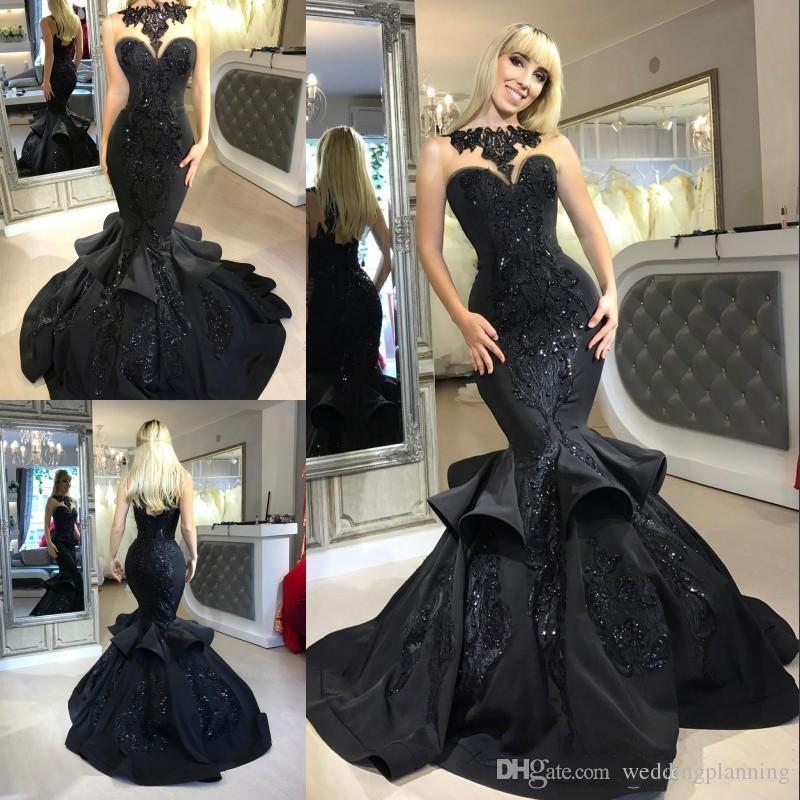 2018 Dubai Arabic Black Mermaid Prom Dresses Beads Sequined Ruffles Floor Length Applique Formal Dresses Evening Wear Evening Dress