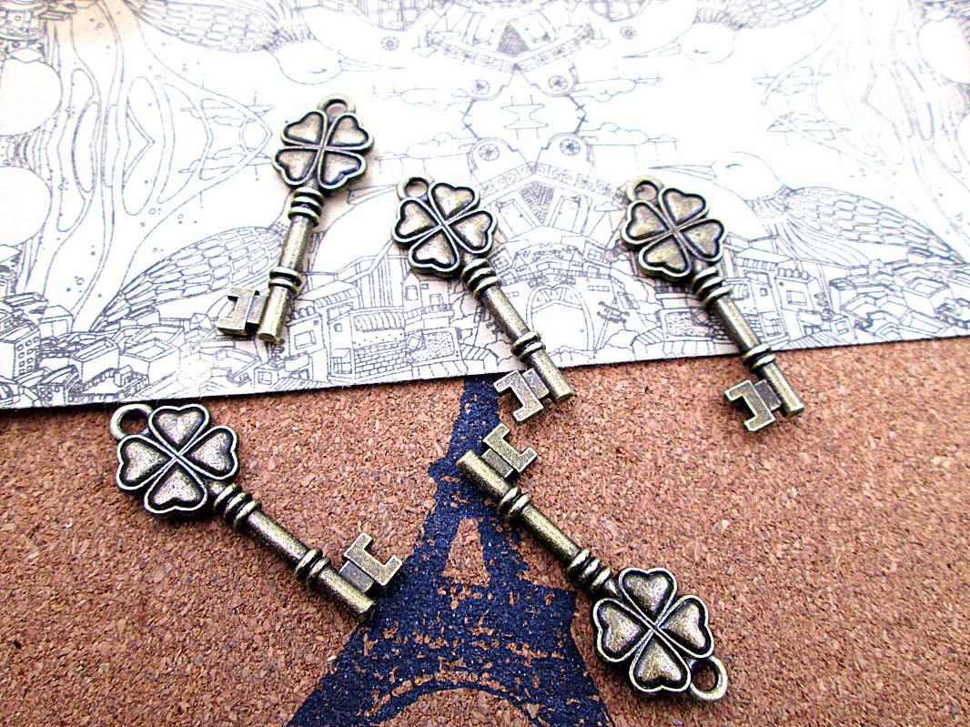 30шт - 38 * 13мм античная бронза 4-листовый клевер ключ подвески