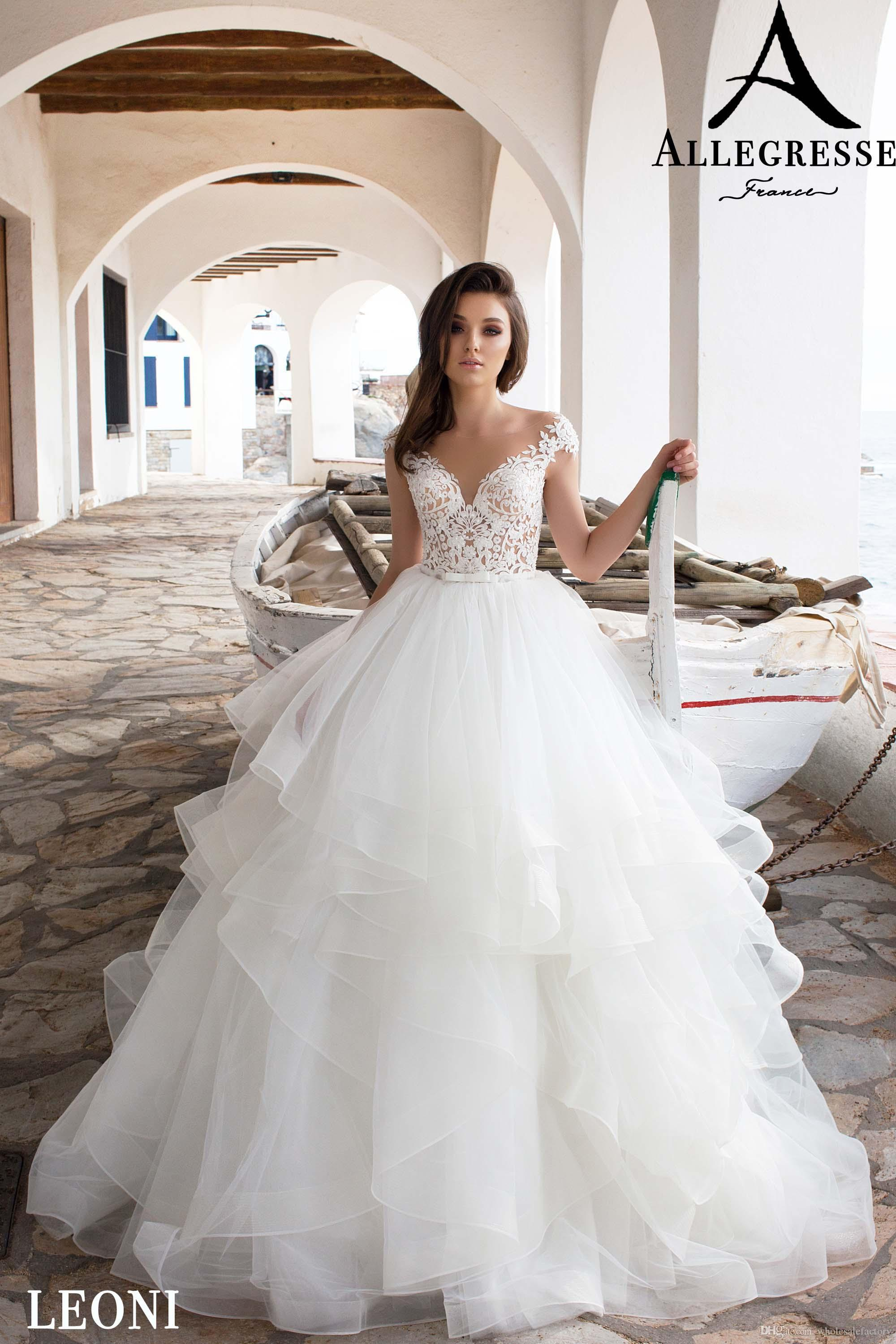 2018 Sheer Cap Sleeves Organza Layered Ruffles Ball Gown Wedding Dresses Lace Applique Seen Through Back Bridal Wedding Gowns With Buttons Wedding
